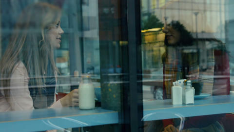 Friends having coffee together in cafe Footage