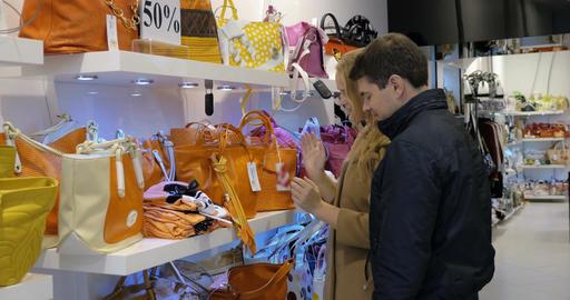 Couple choosing a handbag in the shop Footage