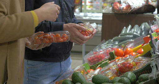 Customers choosing tomatoes in the supermarket Footage