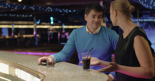 Young people talking and having drinks in the bar Footage