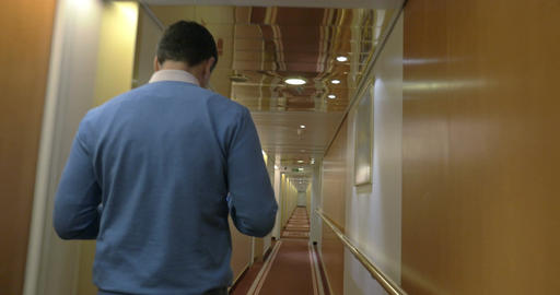 Adult Man Walking Along A Corridor Of Ocean Cruise Ship Footage
