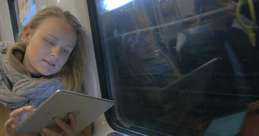 Woman with Tablet Staying in Touch in Metro Train Footage