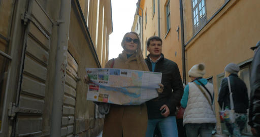 Tourists Walking Around The City Holding A Map Footage