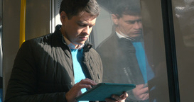 Man with touch pad traveling by train Footage