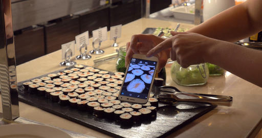 Making photo of sushi with mobile in cafe Footage
