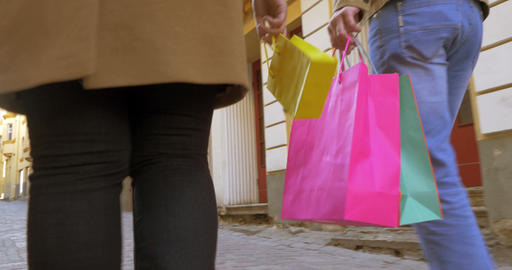 Rear View Of Couple In Holiday Shopping With Shopping Bags stock footage