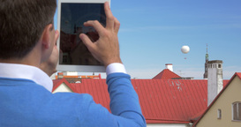 Man Shooting Air Balloon with Tablet Footage