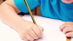 Cute little boy drawing with a pencil Footage