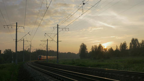 Passenger train in rural area at sunset Footage