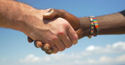 Handshake as symbol of international friendship Live Action