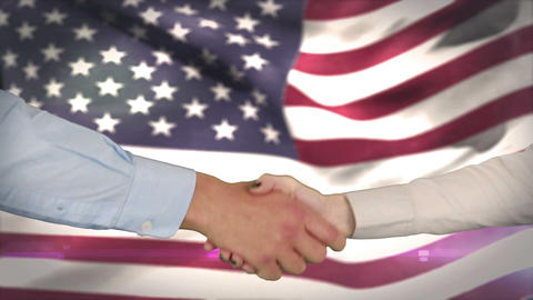 Hands shaking against american flag Animation