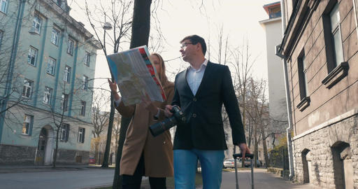 Tourists with city map and camera in the city Footage