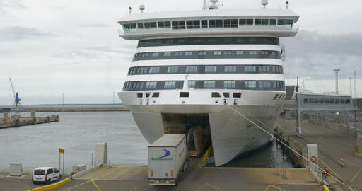 Trucks Boarding the Ferry in Harbor of Tallinn Footage