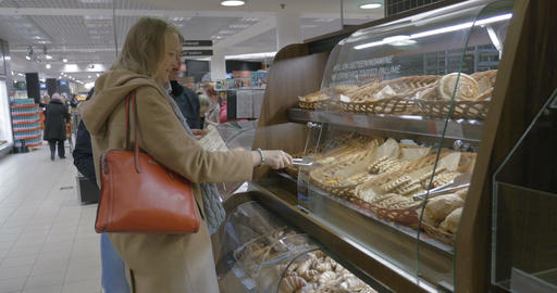 Couple Choosing Bakery in Supermarket Footage