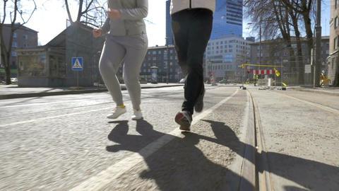 Young sportive couple having run outdoor Live Action