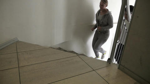 Couple Running Up the Spiral Stairs Footage