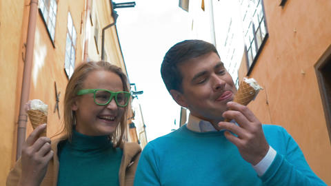 Loving couple having fun with ice-cream outdoor Footage