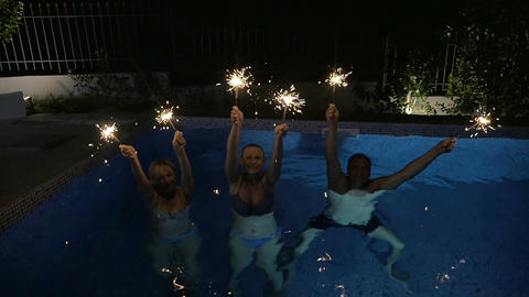 Family or friends with Bengal lights in the pool Footage