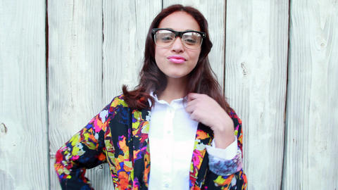 Hipster woman with eyeglasses blowing kiss Live Action