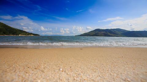 foamy wave surf of azure sea on island sandy beach Footage