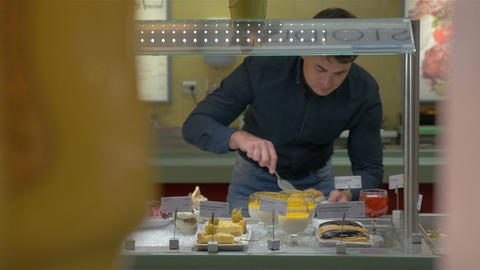 Man Choosing Bakery in Self-Service Buffet Footage