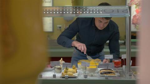 Man Choosing Bakery in Self-Service Buffet Footage