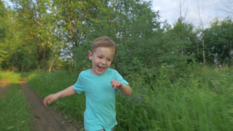 Happy Boy Running In The Park Footage