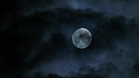 timelapse with full moon moving between clouds, 4k Footage