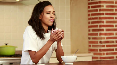 Smiling woman drinking coffee Footage