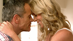 Mature smiling couple having romance Footage