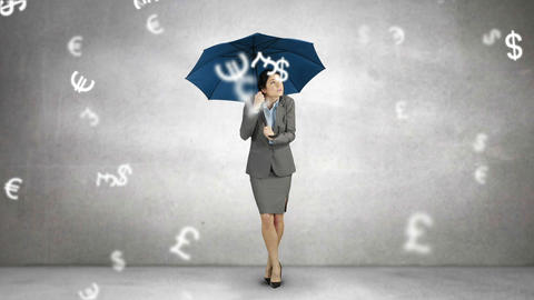 Composite image of businesswoman holding an umbrella Footage