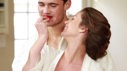 Happy couple sitting and eating strawberries Footage