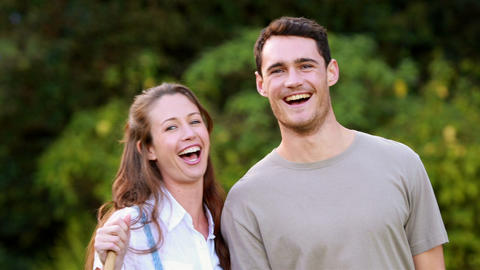 Smiling couple ready to gardening Footage