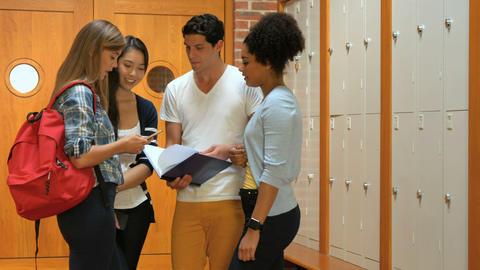 Standing students talking in locker room Footage