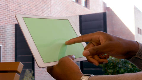 Mans hands using tablet Live Action