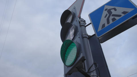 1080p Ungraded: Traffic Light With Pedestrian Crossing Sign Changing Colors Footage