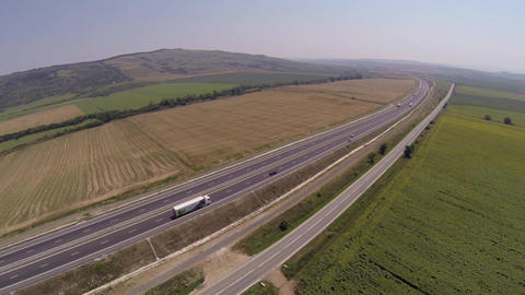 Aerial view of traffic on a highway car and on a national road 143c Footage