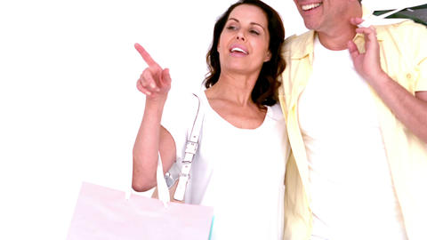 Adult couple holding shopping bags Footage