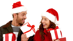 Attractive young couple wearing santa hats with gift Footage