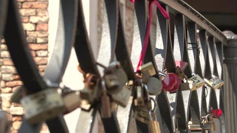Love locks at bridge at Campiello Drio La Pieta in Venice Footage