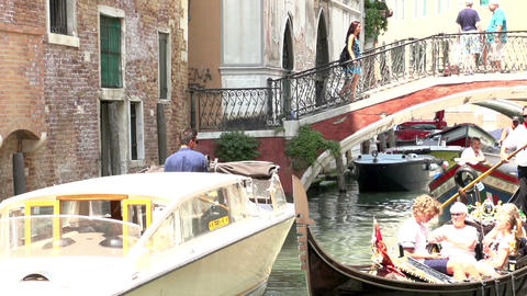 Gondolas in slow motion in a canal in Venice Italy Footage