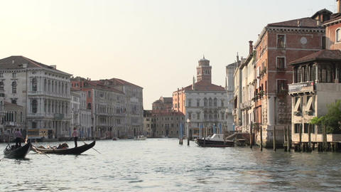 Gondolas in a canal in Venice Italy Footage
