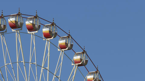 Ungraded: Ferris Wheel At Amusement Park Against Blue Sky stock footage