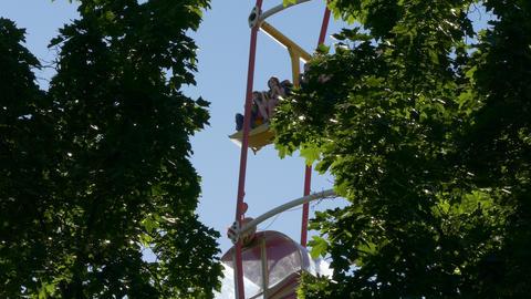 4K Ungraded: Ferris Wheel at Amusement Park Against Blue Sky Footage