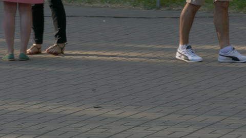 4K Ungraded: Legs of People Standing in Line at Box Office on Street In Footage