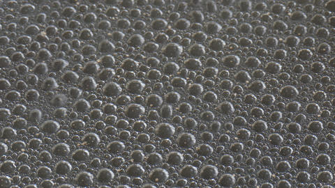 4K Ungraded: Air Bubbles at Bottom of Metal Pan of Boiling Water Footage