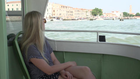 Blond woman sitting on ferry to Venice Footage