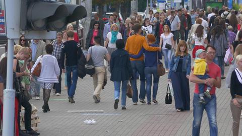 Ungraded: Crowd of People Walking Along Busy Street in Summertime Footage