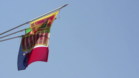 Flags of Italy, European Union and Venice at blue sky in slow motion Footage
