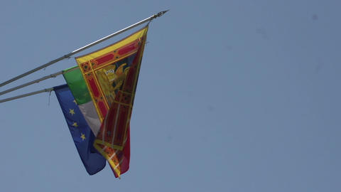 Flags of Italy, European Union and Venice at blue sky Footage